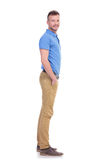 Side of casual young man with hand in pocket Royalty Free Stock Image