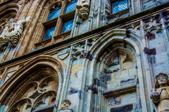 Side of a cathedral. Statues and intricate brickwork on the side of a cathedral Stock Photography