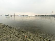 Side of Chaophaya river. In Bangkok on cloudy day Royalty Free Stock Image