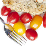 Side of cherry tomatoes with chicken Royalty Free Stock Image