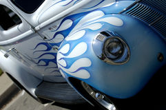 Side of classic car. Front side of vintage car, white with blue flames paint job stock photo