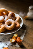 Side close up on a bunch of fresh homemade donuts with sugar and dark wooden background floor Royalty Free Stock Photography