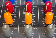 Side closeup on a sliders of a mixing console. Royalty Free Stock Photo