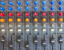 Side closeup on a sliders of a mixing console. Stock Photography