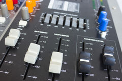 Side closeup on a sliders of a mixing console. Royalty Free Stock Images