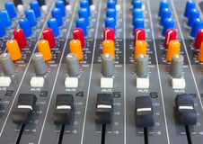 Side closeup on a sliders of a mixing console. Stock Image