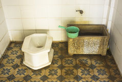 Side closeup toilet in rural thailand. Royalty Free Stock Photography