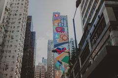 SIDE OF COLORFUL BUILDING IN HONG KONG. City center with graffiti nd colorful building in Hong kong royalty free stock photos