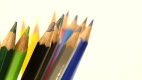Side of colour pencils isolated on white, rotation stock footage