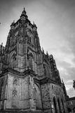 Side column of the gothic Vysehrad cathedral in Prague featuring beautiful windows and stone wall and pillars stock photos