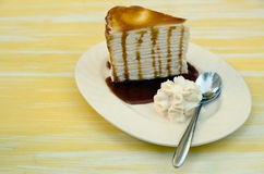 Side of Cream cake topped with caramel Stock Image