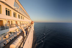 Side of a cruise ship bathed in early morning sun Royalty Free Stock Image