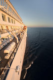 Side of a cruise ship bathed in early morning sun Stock Photos