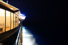 Side of cruise ship at night royalty free stock photos