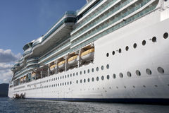 Side of Cruise Ship from Water. Side of a luxury cruise ship shot from water level Royalty Free Stock Images