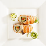 Side dish with chicken roll. Side dish with roll of oven baked chicken, rice and vegetables Stock Photos
