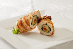 Side dish with chicken roll. Side dish with roll of oven baked chicken, rice and vegetables Stock Images