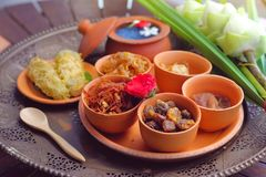 Side dish of Kao Chae set in pottery, Thai traditional food. Usually eat in summer or songkran festival Royalty Free Stock Image