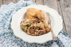 A side dish of quinoa with mushrooms and fried chicken leg Stock Photography