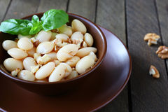 Side dish of white beans with nuts Stock Photos