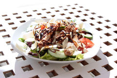 Side dish on white plate, grilled chicken and salad Stock Photos