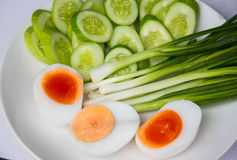 Side dishes, bolied eggs, slice cucumber leek, Royalty Free Stock Images