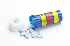 Side Effects. Blue prescription bottle with side effects stickers and blue pills Royalty Free Stock Image