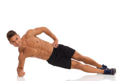 Side Elbow Plank. Isometric Stomach Exercise Stock Photo