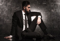 Side of an elegant business man in black suit. And tie looking away Stock Photos