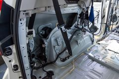 The side element of the car`s interior in the back of the crossover without skin, prepared for repair and performance of noise. Insulation in the car service stock photo