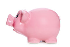 Side elevation of isolated pink piggy bank. Isolated side view of pink piggy bank on white background Stock Images