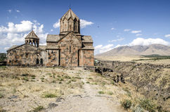 Side elevation on the monastery Ohanavank over the precipice at canyon river Kasakh Royalty Free Stock Photo