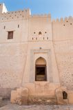 Side entrance into desert fortress. Gates leading into a desert fortress in Oman Royalty Free Stock Photo