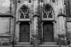 Side entrance of the gothic Vysehrad cathedral in Prague surrounded by beautiful stone wall and pillars Stock Photos