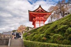 Side Entry to Kiyomizu-dera buddhist temple, Kyoto, Japan. Kyoto, Japan - November 2, 2018: People visiting the iconic Kiyomizu-dera buddhist temple on a royalty free stock photography