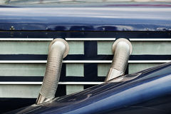 Side exhaust pipes on old classic car Stock Photo