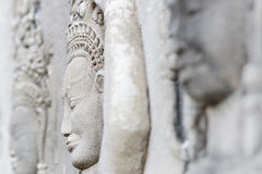 Side face of fairy relief in Angkor Wat. Stock Image
