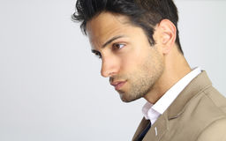 Side face of an handsome man. Over a white background Stock Photo