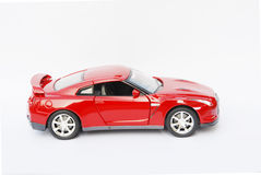 Side face of a red model sport car. Side face of a red metal model sport car Stock Photo