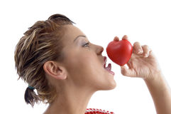 Side face of woman licking a heart Royalty Free Stock Images