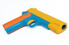 A colorful toy pistol hand gun stock image