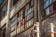 Side of a factory. Windows on the side of a deserted factory Stock Images