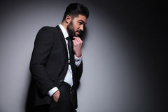 Side of fashion man with hand on beard Stock Images