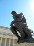 Side front profile of the masterpiece the Thinker by Rodin. The Thinker at the entrance of the Palace of the Legion of Honor in San Francisco with sunlight royalty free stock image