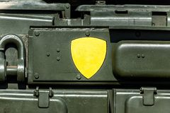 Side of green metal military vehicle stock photography
