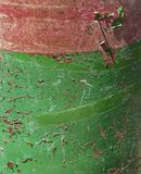 Side of green and red cannister. Closeup of green and red rusted container Royalty Free Stock Photography