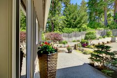Side of the house woth yard landscape and window. Royalty Free Stock Photography