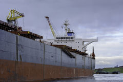 Side of a huge bulk carrier. Stock Images