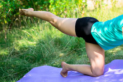 The side knee yoga posture position Royalty Free Stock Photo