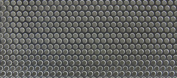 Side light metal grate background. Side light metal grate showing circles highlighted Royalty Free Stock Image